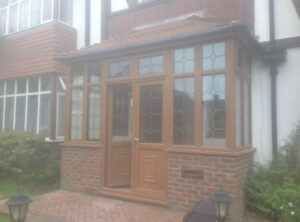 Whilst the PVCu porch was of good quality our customer wanted a more traditional look to her home.
