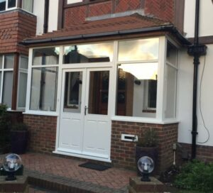 The new quality engineered timber porch with new windows and doors.