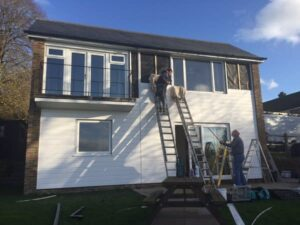 As well as new windows, the exterior of this house is enhanced with PVCu cladding.
