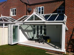 White folding doors in a conservatory.
