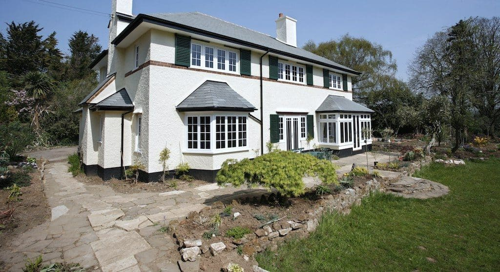 aluminium replacement windows in a traditional style and white colour