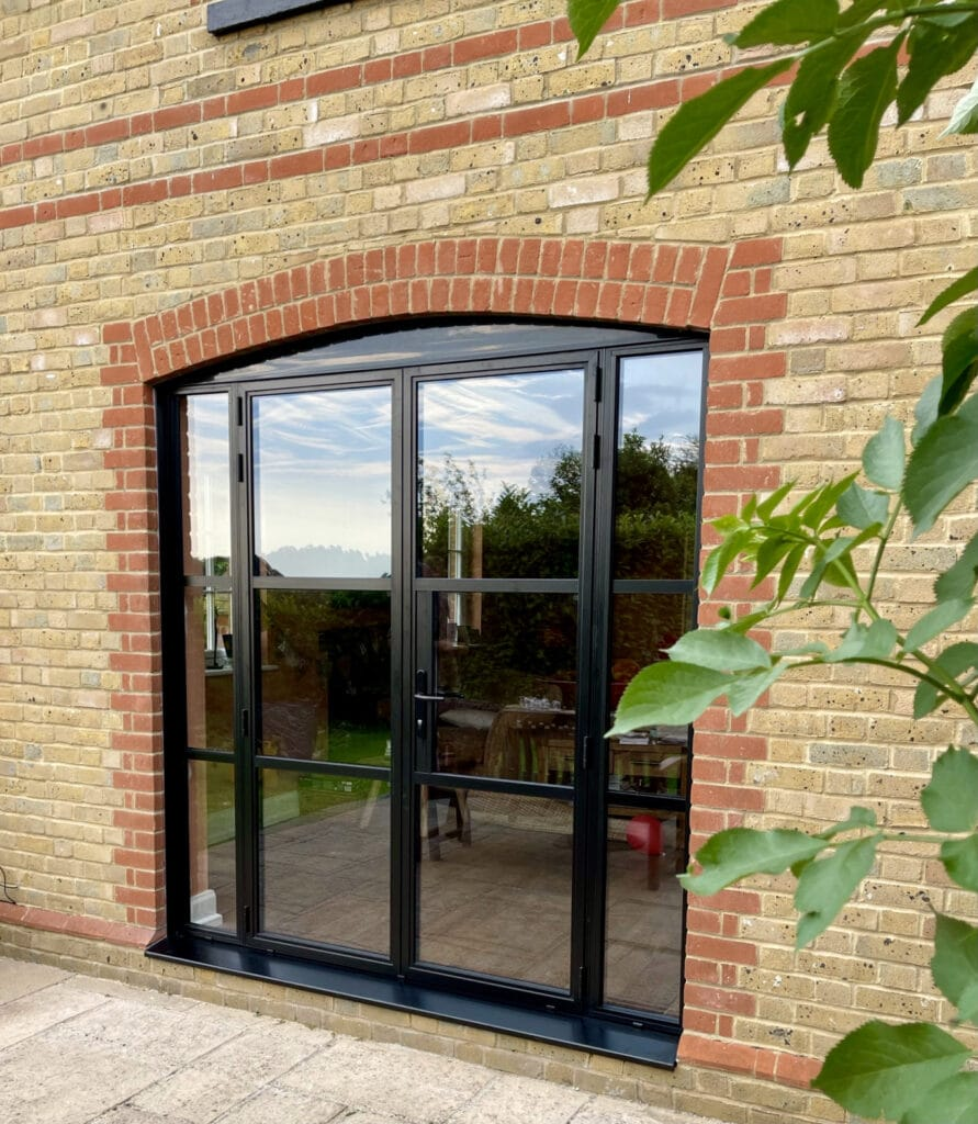 Crittall style doors in Kent house with feature arch above